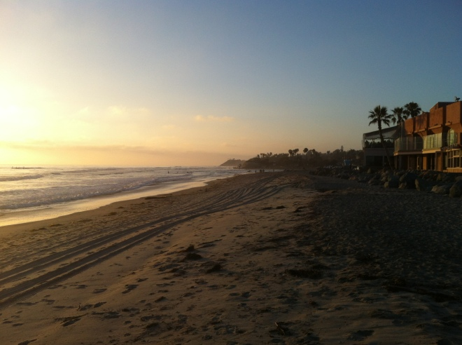 Sunset, sand, surfers.